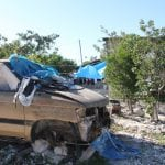 an-abandoned-car-serves-as-home-to-haitian-workers