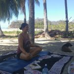 danni-mares-and-her-dog-gus-show-up-every-morning-at-8-a-m-on-playa-samara-to-teach-yoga