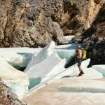 charly-surveys-the-icy-route-on-baba-creek-near-summit-lake