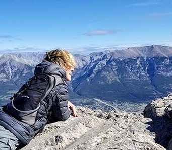 Travel Like This editor Lisa Monforton gazing over Ha-Ling-Peak