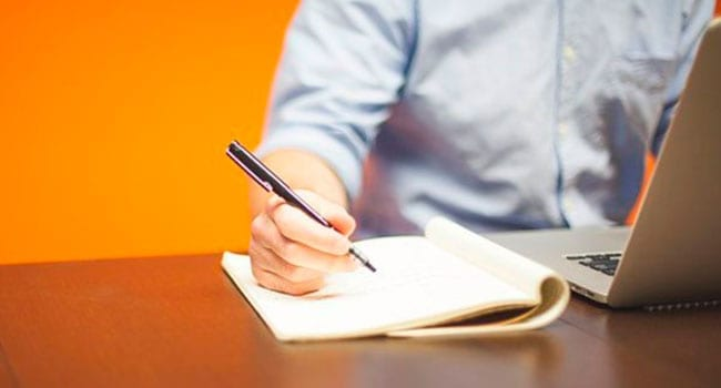 Entrepreneur doing paperwork to manage his business