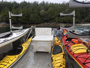 The kayak conveyance on an aluminum barge out to the Broken Group Islands in British Columbia from Toquaht Bay on the first day. Photo by Mike Robinson