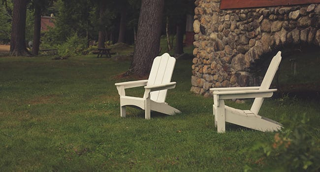Outdoor chairs on lawn in backyard