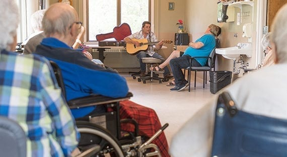 When Dr. Music makes his rounds, the patients gather round